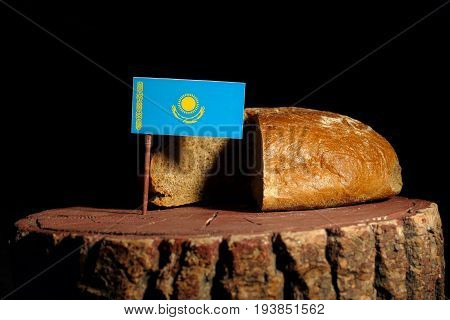 Kazakhstan Flag On A Stump With Bread Isolated