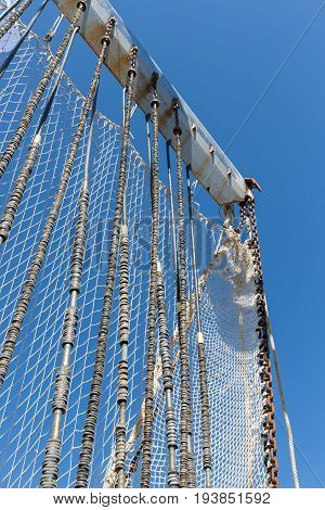 Fishnet hanging at a crane drying in the wind