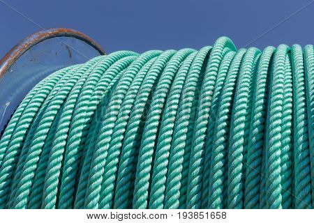 Detail of a big fishing winch with nylon rope