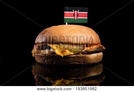 Kenyan Flag On Top Of Hamburger Isolated On Black Background