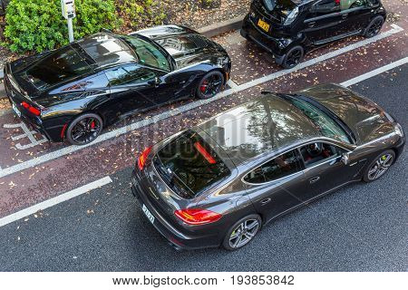TOKYO, JAPAN - NOVEMBER 12, 2016: Luxury cars on the street of Tokyo, Japan. Tokyo Metropolis is both the capital and most populous city of Japan.