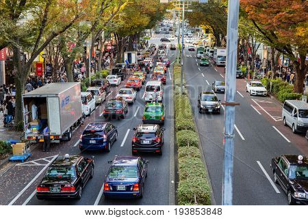 TOKYO, JAPAN - NOVEMBER 12, 2016: Cars in huge traffic on the street of Tokyo, Japan. Tokyo Metropolis is both the capital and most populous city of Japan.