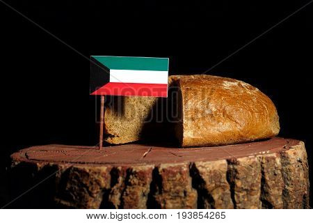 Kuwaiti Flag On A Stump With Bread Isolated