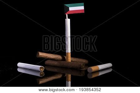 Kuwaiti Flag With Cigarettes And Cigars. Tobacco Industry Concept.