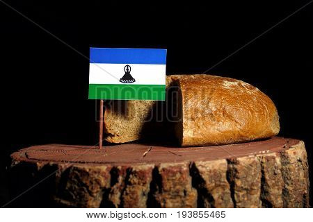 Lesotho Flag On A Stump With Bread Isolated