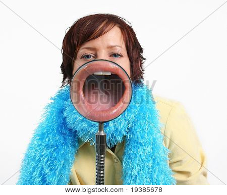 Girl with a magnifying glass in front of her mouth
