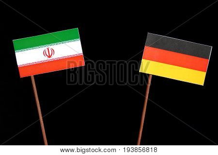 Iranian Flag With German Flag Isolated On Black Background