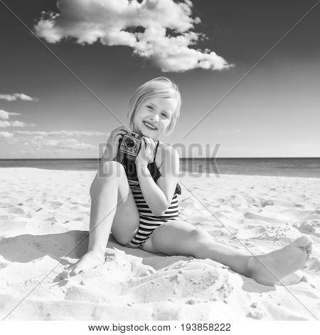 Happy Healthy Girl On Seacoast With Retro Photo Camera