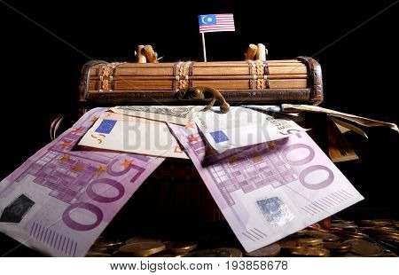 Malaysian Flag On Top Of Crate Full Of Money