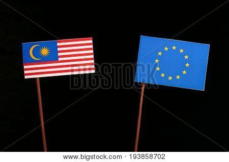 Malaysian Flag With European Union (eu) Flag Isolated On Black Background