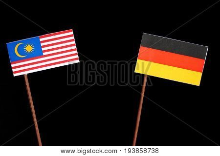 Malaysian Flag With German Flag Isolated On Black Background