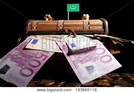 Mauritanian Flag On Top Of Crate Full Of Money