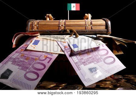 Mexican Flag On Top Of Crate Full Of Money