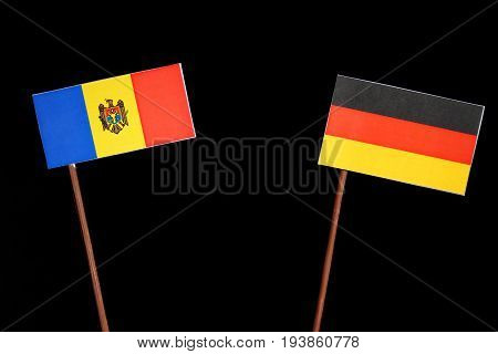 Moldovan Flag With German Flag Isolated On Black Background