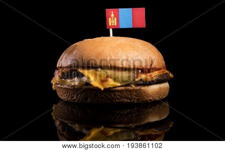 Mongolian Flag On Top Of Hamburger Isolated On Black Background