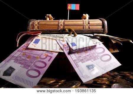 Mongolian Flag On Top Of Crate Full Of Money