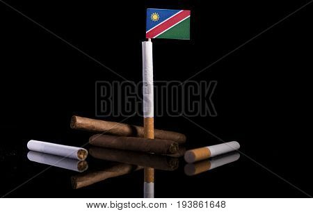 Namibian Flag With Cigarettes And Cigars. Tobacco Industry Concept.