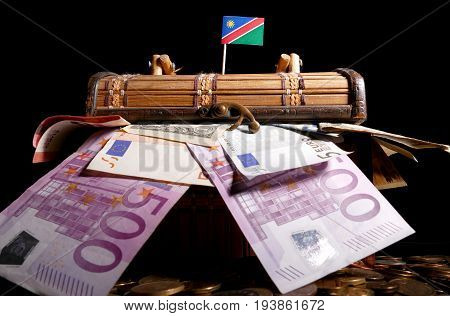 Namibian Flag On Top Of Crate Full Of Money