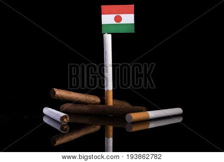 Niger Flag With Cigarettes And Cigars. Tobacco Industry Concept.