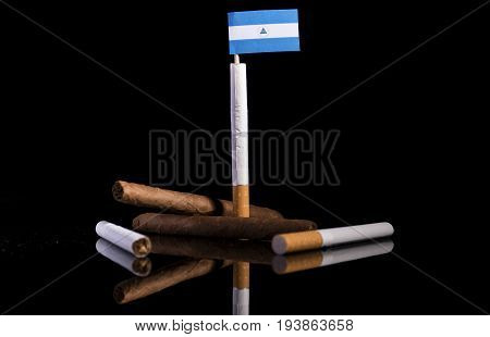 Nicaraguan Flag With Cigarettes And Cigars. Tobacco Industry Concept.