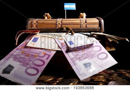 Nicaraguan Flag On Top Of Crate Full Of Money