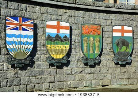 Victoria BC,Canada,March 3rd 2015.The coats of arms for the Canadian provinces of BC,Alberta,Saskatchewan and Manitoba hang on a wall in Victoria BC.