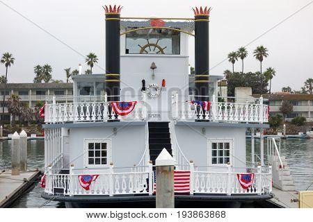 OXNARD CA USA - JULY 4 2013: Scarlett Belle double decker recreational ship in City of Oxnard marina decorated for 4th of July celebration Ventura county Southern California coast