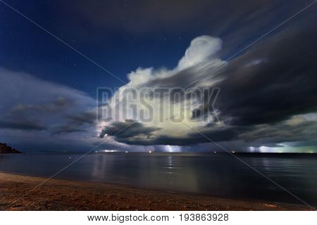 Lightning above the sea in tropical night at the beach.Thailand