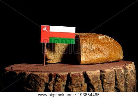 Omani Flag On A Stump With Bread Isolated