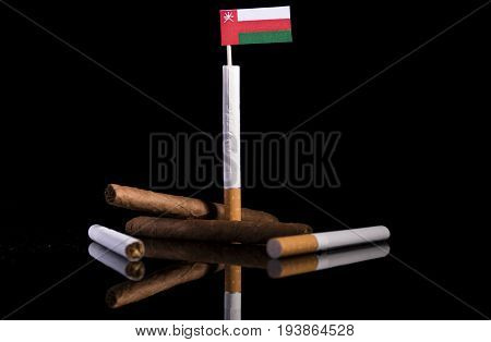 Omani Flag With Cigarettes And Cigars. Tobacco Industry Concept.