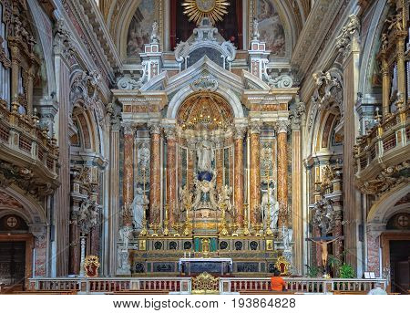 The apse and the main altar of the Church of Gesù Nuovo with the majestic statue of the Virgin resting on a large globe in the middle - Naples, Campania, Italy, , 29 October 2011