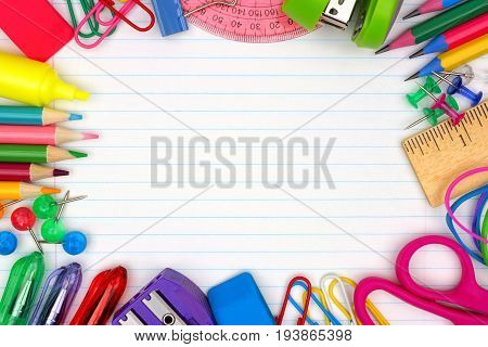 Colorful School Supplies Frame Over A Lined Paper Background