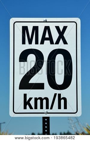Speed zone sign of 20 km/hr.Slow down