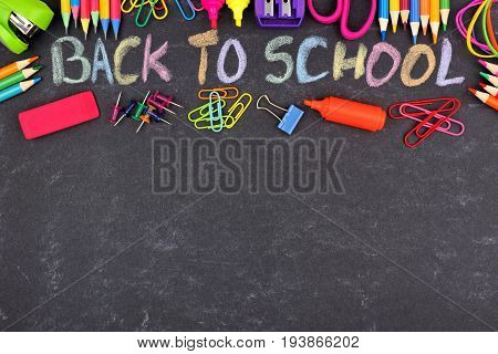 School Supplies Top Border With Back To School Written In Colorful Chalk With Against A Chalkboard B