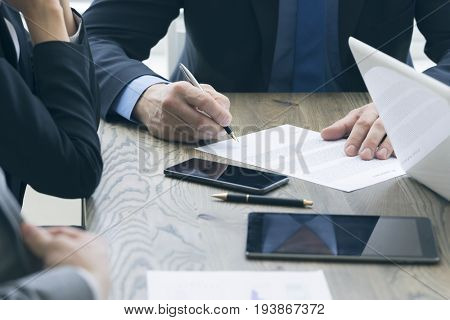 Business man sign contract on the desk at meeting