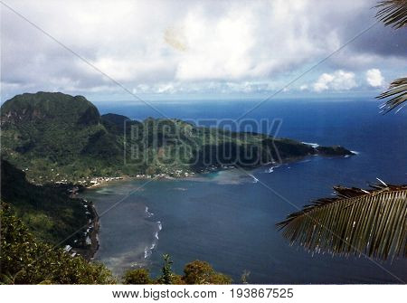 A view of the coast of Tutuila Island, and Pago Pago Harbor, from the top of Mount Alava, above Pago Pago, American Samoa.