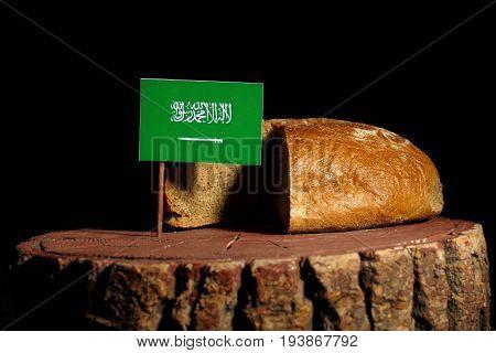 Saudi Arabian Flag On A Stump With Bread Isolated