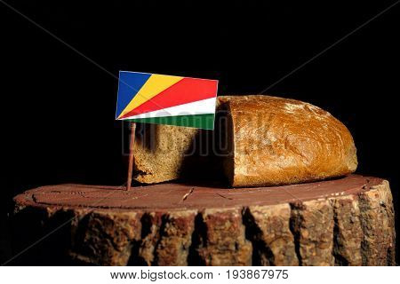 Seychelles Flag On A Stump With Bread Isolated