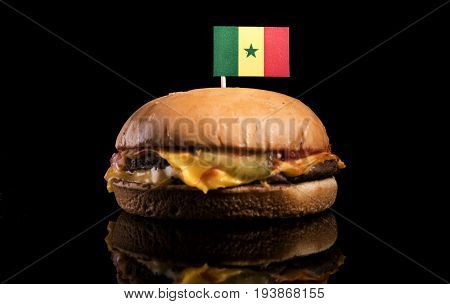 Senegal Flag On Top Of Hamburger Isolated On Black Background