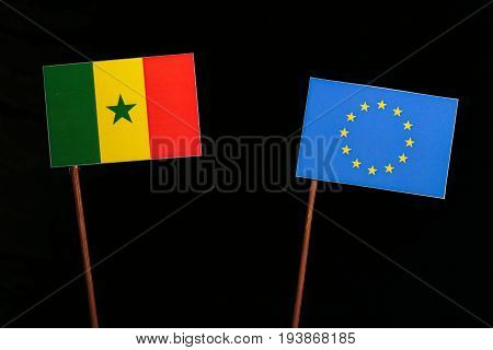 Senegal Flag With European Union (eu) Flag Isolated On Black Background