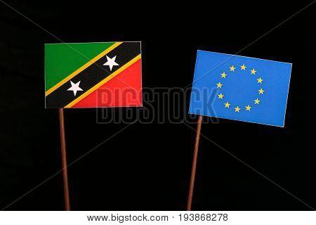 Saint Kitts And Nevis Flag With European Union (eu) Flag Isolated On Black Background