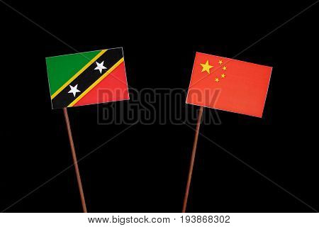 Saint Kitts And Nevis Flag With Chinese Flag Isolated On Black Background