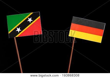 Saint Kitts And Nevis Flag With German Flag Isolated On Black Background