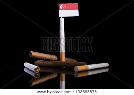 Singaporean Flag With Cigarettes And Cigars. Tobacco Industry Concept.