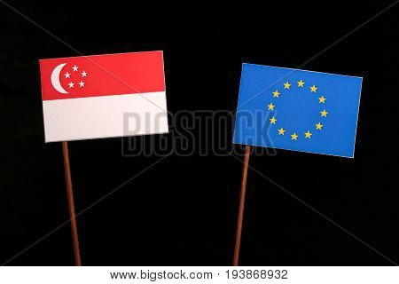 Singaporean Flag With European Union (eu) Flag Isolated On Black Background