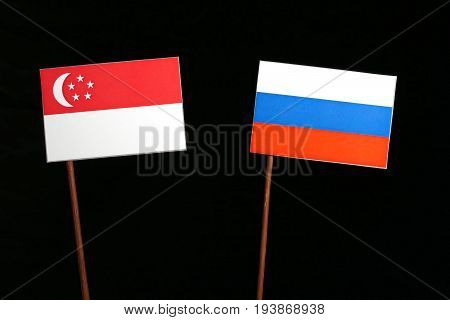 Singaporean Flag With Russian Flag Isolated On Black Background
