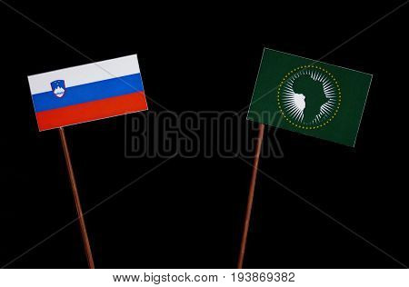 Slovenian Flag With African Union Flag Isolated On Black Background