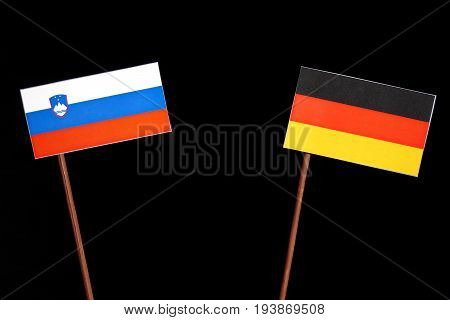 Slovenian Flag With German Flag Isolated On Black Background
