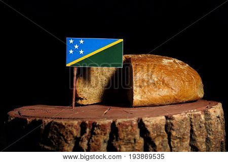 Solomon Islands Flag On A Stump With Bread Isolated
