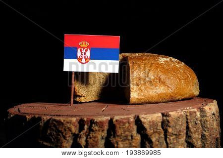 Serbian Flag On A Stump With Bread Isolated